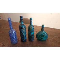 Set bottiglie decorate in vetro